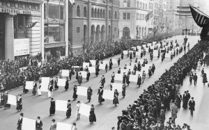 Suffragists parade down Fifth Avenue, October 1917, displaying placards containing the signatures of more than one million New York women demanding the vote. The New York Times Photo Archives