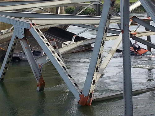 NBC 5 in Seattle: Photo of man on his car in Skagit River after I-5 bridge collapse.