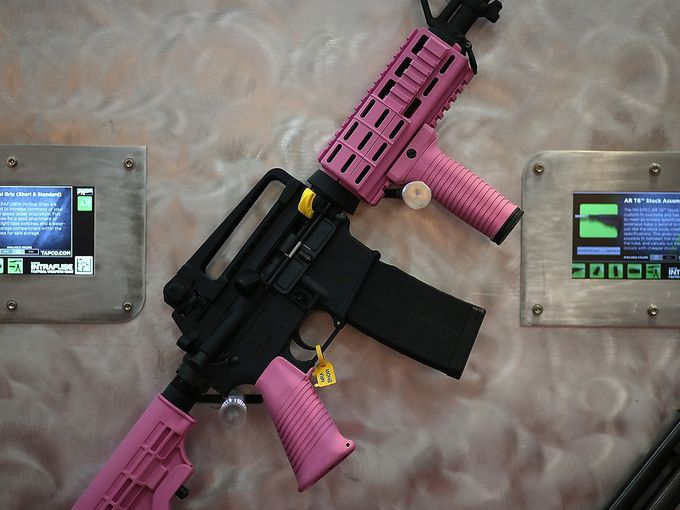 An AR-15 rifle is accessorized with a pink hand guard, vertical grip, pistol grip and stock assembly. Justin Sullivan- Getty images