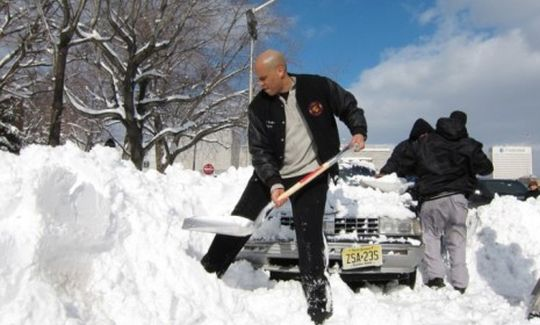 Newark Mayor Cory Booker shoveling snow for constituents in 2010 (Natalia Jimenez/Star Ledger/Corbis)