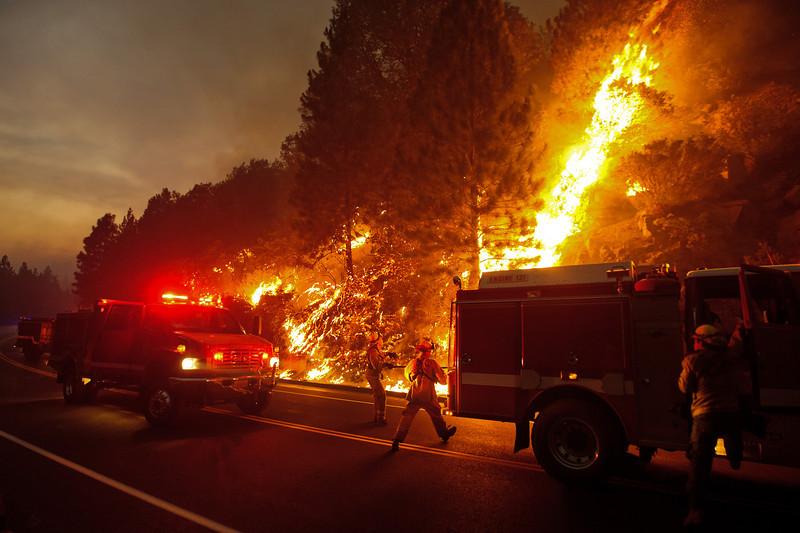 A firefighter uses a hose to douse the flames of the Rim Fire on August 24, near Groveland, Calif. The Rim Fire continues to burn out of control and threatens 4,500 homes outside of Yosemite National Park.  Justin Sullivan, Getty Images