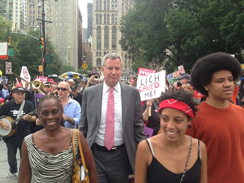 Public Advocate Bill de Blasio today joined doctors, nurses, health care workers and activists at a major rally to protest the closure of Long Island College Hospital and Interfaith Medical Center.  Seen here with his wife, Chirlane, and kids, Chiara and Dante. Image via Wiki.