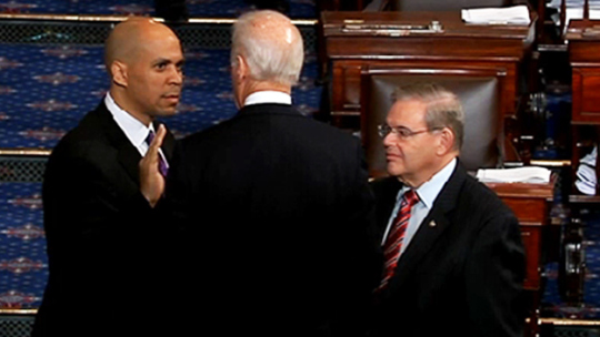 Senator Cory Booker is sworn in by vice President Joe Biden (CBS)