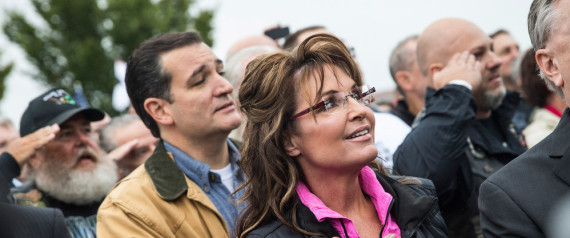 WASHINGTON, DC - OCTOBER 13:  Former Alaskan Governor Sarah Palin (R) and Sen. Ted Cruz (R-TX) recite the Pledge of Allegiance at a rally supported by military veterans, Tea Party activists and Republicans, regarding the government shutdown on October 13, 2013 in Washington, DC.  (Photo by Andrew Burton/Getty Images)