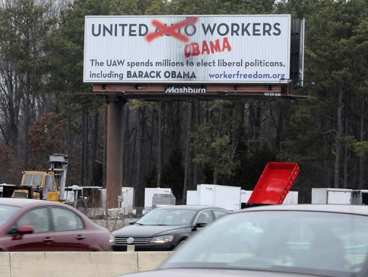 An anti-UAW union message is visible on a billboard for northbound motorists in Chattanooga, Tenn. The sign misspells the word politician. Photo: Tim Barber, Chattanooga Times Free Press/USA Today