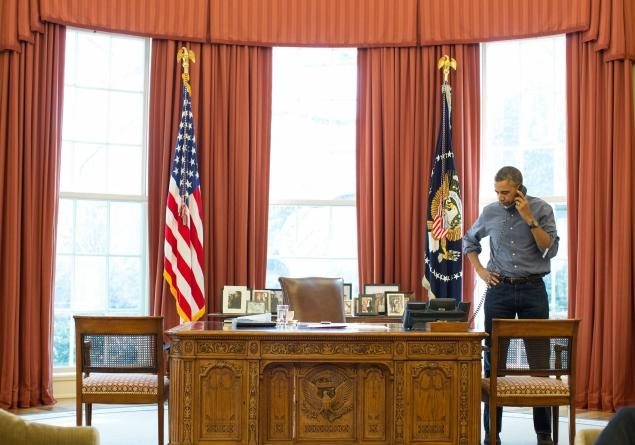 President Obama talking on the phone in the Oval Office with Russian President Vladimir Putin about the situation in Ukraine on Saturday. Photo by Pete Souza