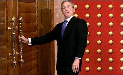 http://www.bobcesca.com/images/Bush-door-idiot.jpg
