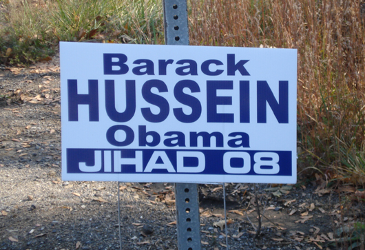 obama_racist_sign_hussein.jpg