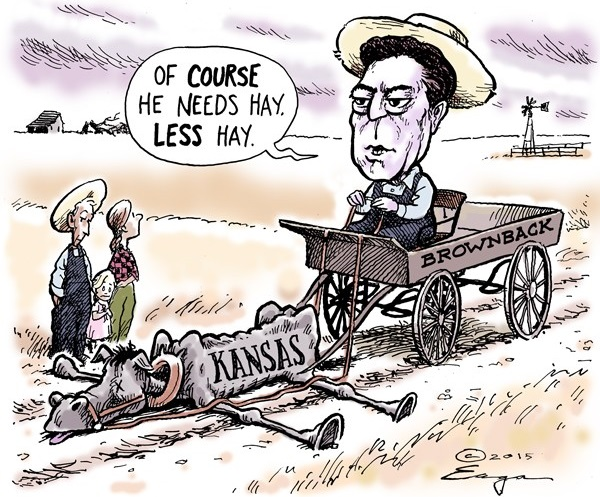 Sam Brownback in wagon labeled